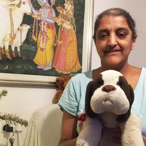 Nisha at home with her favourite comforting toy, Groucho